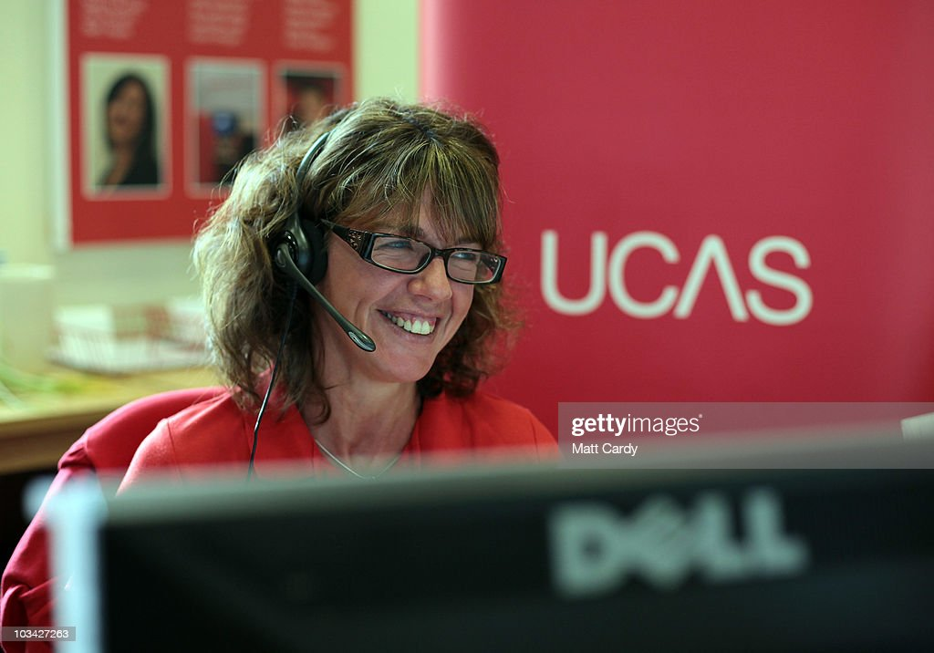 Sarah Hillier, an employee in the UCAS clearing house call centre, smiles as she answers a student's enquiry as she prepares to assist A-level students ahead of results day on August 18, 2010 in Cheltenham, England. With A-level results published in England and Wales tomorrow, the university admissions service (UCAS) say they are expecting 'even greater' pressure this year during the clearing process - which matches students who have been turned down by their original choices, to other courses. A record 170,000 students will miss out on places at university, which is due to the record number of applicants, up 11.6 percent this year.