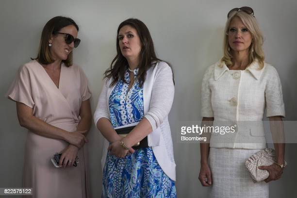 Sarah Huckabee Sanders White House press secretarydesignate center and Kellyanne Conway senior advisor to US President Donald Trump right listen...
