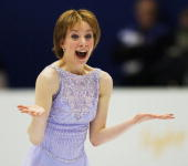 Sarah Hughes reacts at the end of her women's free program of the figure skating event at the Olympic Ice Center 21 February 2002 during the XIXth...