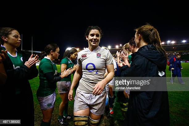 Sarah Hunter of England leads the England team being applauded off the pitch by the Irish team after their victory in the Women's International match...