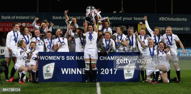 Sarah Hunter the England captain raises the trophy after their Grand Slam victory during the Womens Six Nations match between Ireland Women v England...