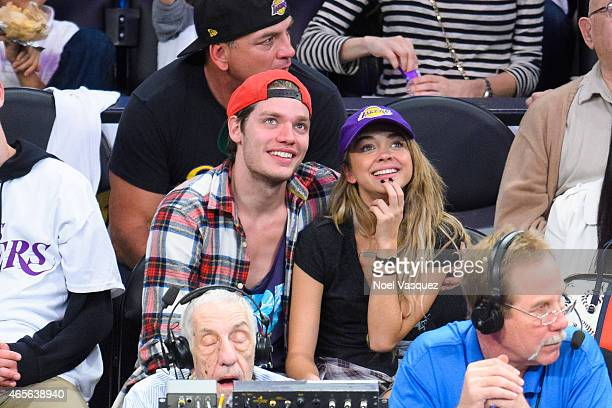Sarah Hyland and Dominic Sherwood attend a basketball game between the Dallas Mavericks and the Los Angeles Lakers at Staples Center on March 8 2015...
