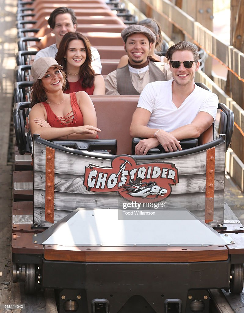 Sarah Hyland Dominic Sherwood with Katie Stevens and character 'Looking Glass Theo' riding a roller coaster at the GHOSTRIDER Reopening @ Knott's...