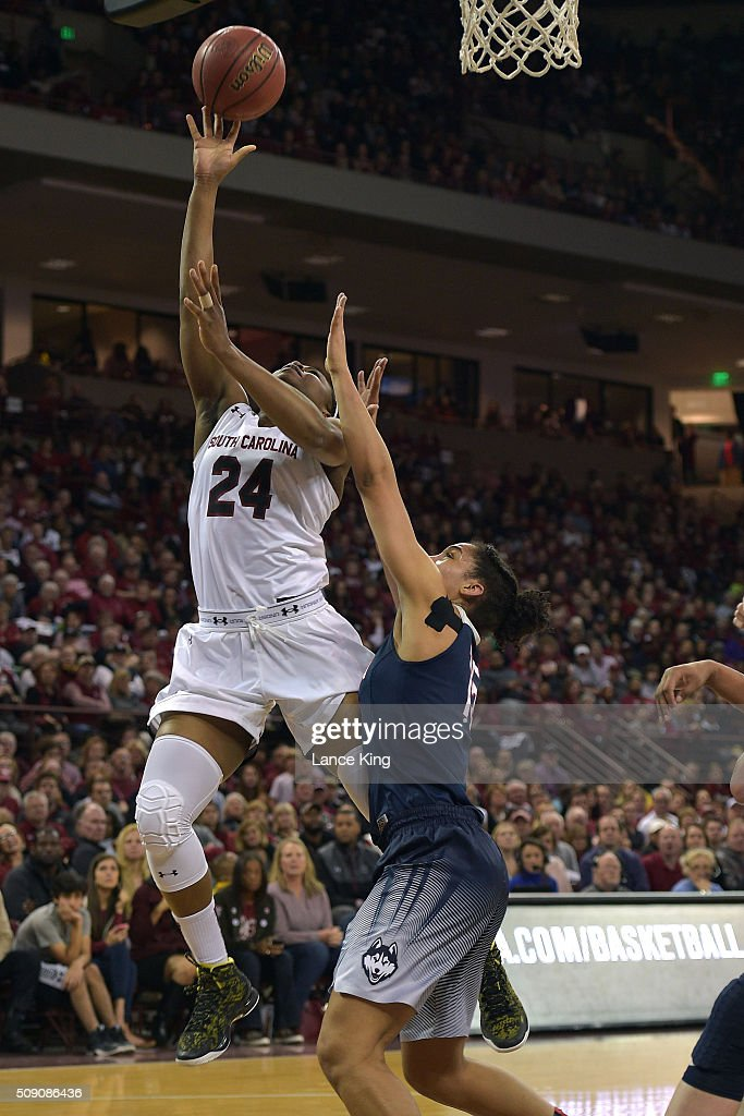 Sarah Imovbioh #24 of the South Carolina Gamecocks goes to the basket against Gabby Williams #15 of the Connecticut Huskies at Colonial Life Arena on February 8, 2016 in Columbia, South Carolina.