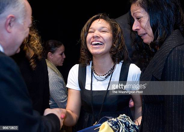 Sarah Jackson center shares a laugh with Steven Knapp GW president as her mother Allison Jackson in brought to tears Friday morning at Banneker High...