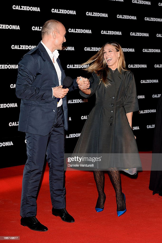 Sarah Jessica Parker and Alfonso Signorini arrive at the Calzedonia 'Forever Together' show on April 16, 2013 in Rimini, Italy.