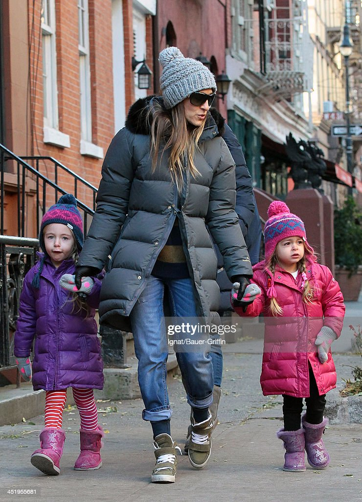 <a gi-track='captionPersonalityLinkClicked' href=/galleries/search?phrase=Sarah+Jessica+Parker&family=editorial&specificpeople=201693 ng-click='$event.stopPropagation()'>Sarah Jessica Parker</a> and her twin daughters, Loretta Broderick and Tabitha Broderick are sighted on November 25, 2013 in New York City.