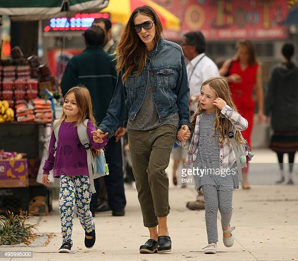 Sarah Jessica Parker and twin daughters Tabitha and Marion enjoy a stroll on November 5 2015 in New York City