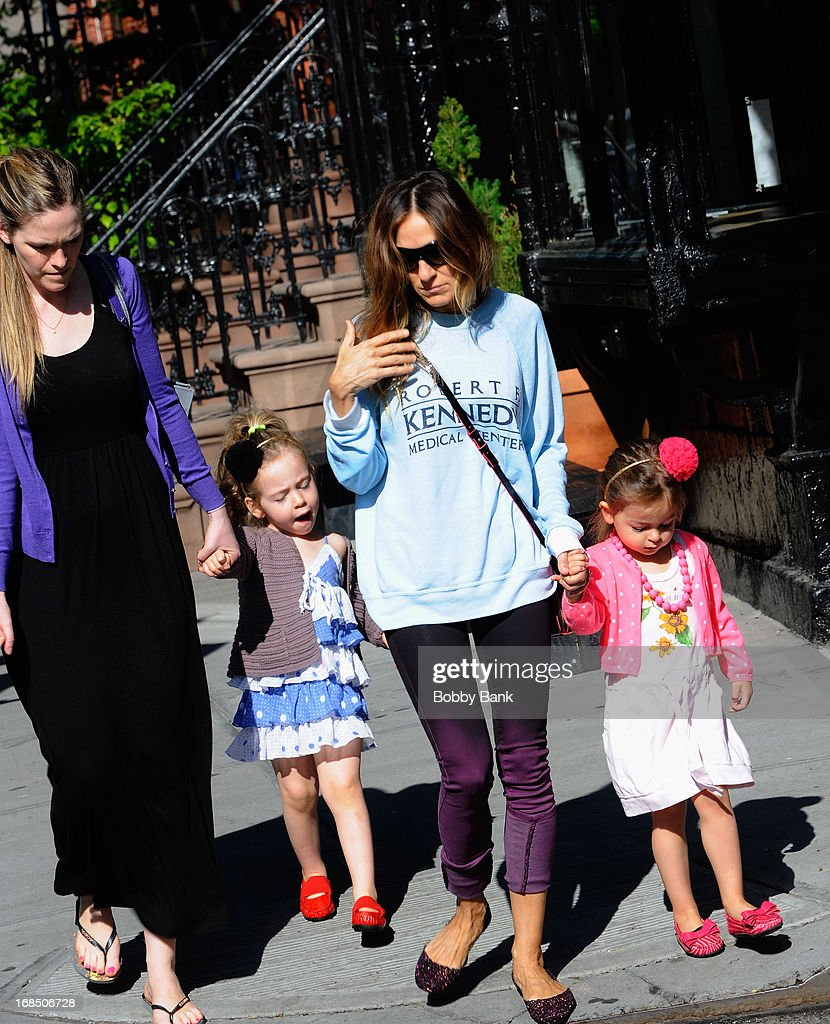 <a gi-track='captionPersonalityLinkClicked' href=/galleries/search?phrase=Sarah+Jessica+Parker&family=editorial&specificpeople=201693 ng-click='$event.stopPropagation()'>Sarah Jessica Parker</a> with her twin daughters, Tabitha Broderick and Marion Broderick in the West Village on May 10, 2013 in New York City.