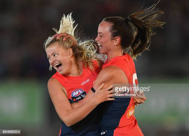 Sarah Jolly of the Demons is congratulated by Daisy Pearce of the Demons after kicking a goal during the round two AFL Women's match between the...