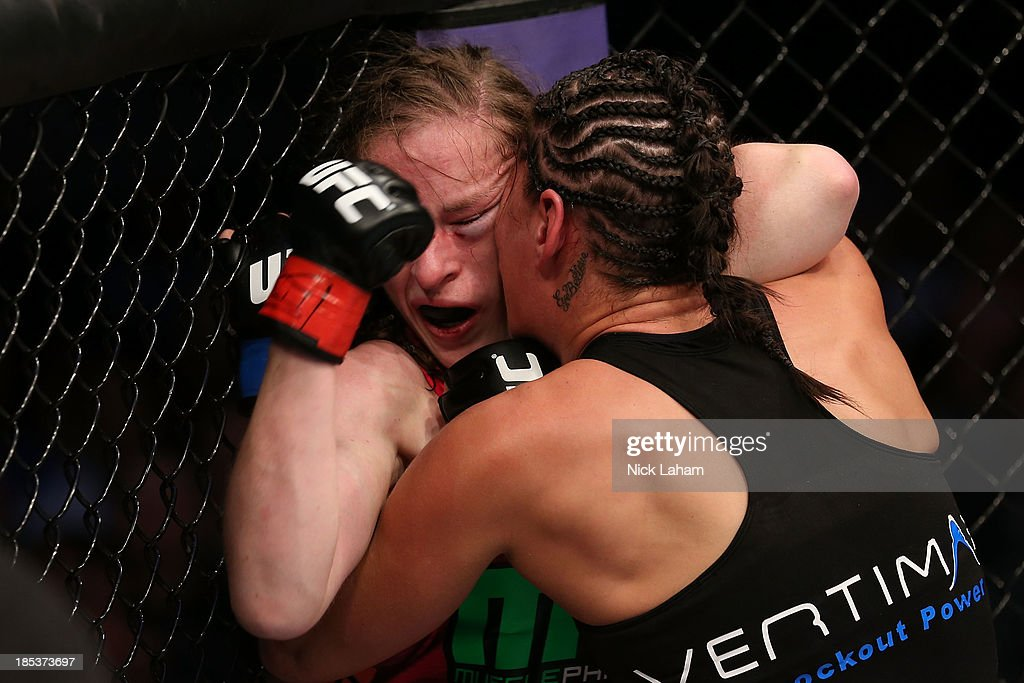 Sarah Kaufman gets pushed into the cage by Jessica Eye in their UFC women's bantamweight bout at the Toyota Center on October 19 2013 in Houston Texas
