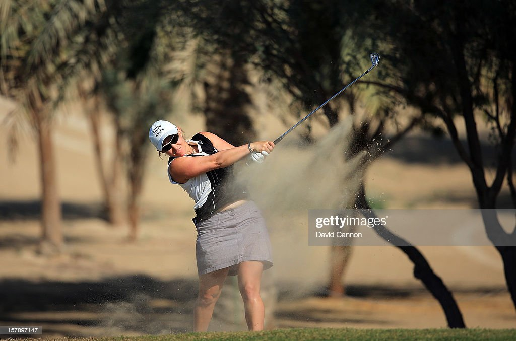 Sarah Kemp of England plays her second shot at the par 4, 14th hole during the third round of the 2012 Omega Dubai Ladies Masters on the Majilis Course at the Emirates Golf Club on December 7, 2012 in Dubai, United Arab Emirates.