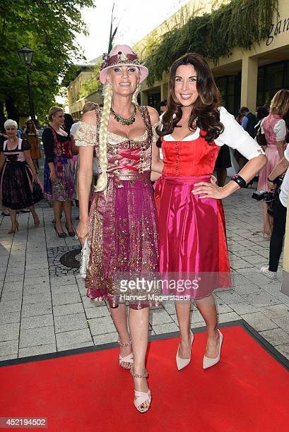 Sarah Kern and Alexandra PolzinLeinauer attend the Sixt ladies dirndl dinner on July 15 2014 in Munich Germany