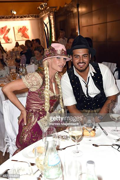 Sarah Kern and Arman Amjadi attend the Sixt ladies dirndl dinner on July 15 2014 in Munich Germany