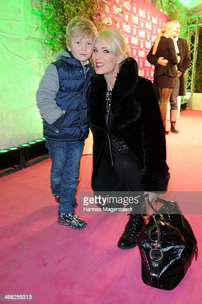 Sarah Kern and her son Romeo attend 'Cirque Du Soleil' Kooza 2014 Munich Premiere at Theresienwiese on January 31 2014 in Munich Germany