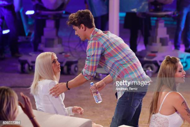 Sarah Knappik chats with Dominik Bruntner during the finals of 'Promi Big Brother 2017' at MMC Studio on August 25 2017 in Cologne Germany
