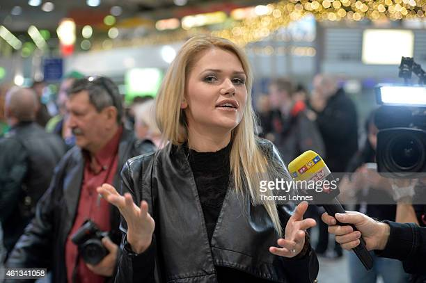 Sarah Kulka poses before the flight to Australia as a participant in the 2015 RTLTVShow 'Dschungelcamp Ich bin ein Star Holt mich hier raus' at...