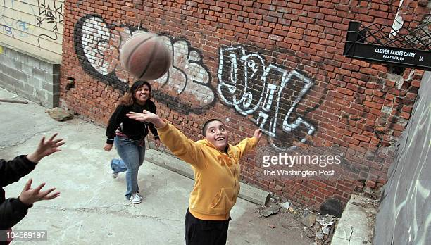 Sarah L Voisin/TWP id# 178576 Brooklyn New York Three mexican children play basketball on their homemade court in Williamsburg Oscar Benitez cq...