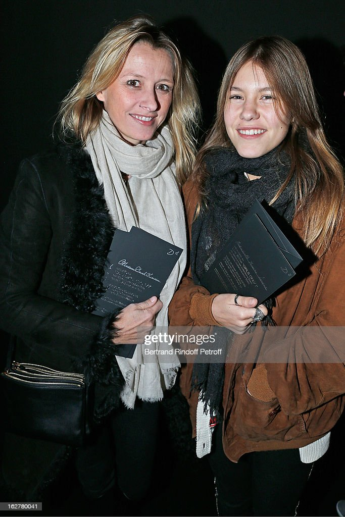 Sarah Lavoine and daughter Yasmine arrive to the Etam Live Show Lingerie at Bourse du Commerce on February 26, 2013 in Paris, France.