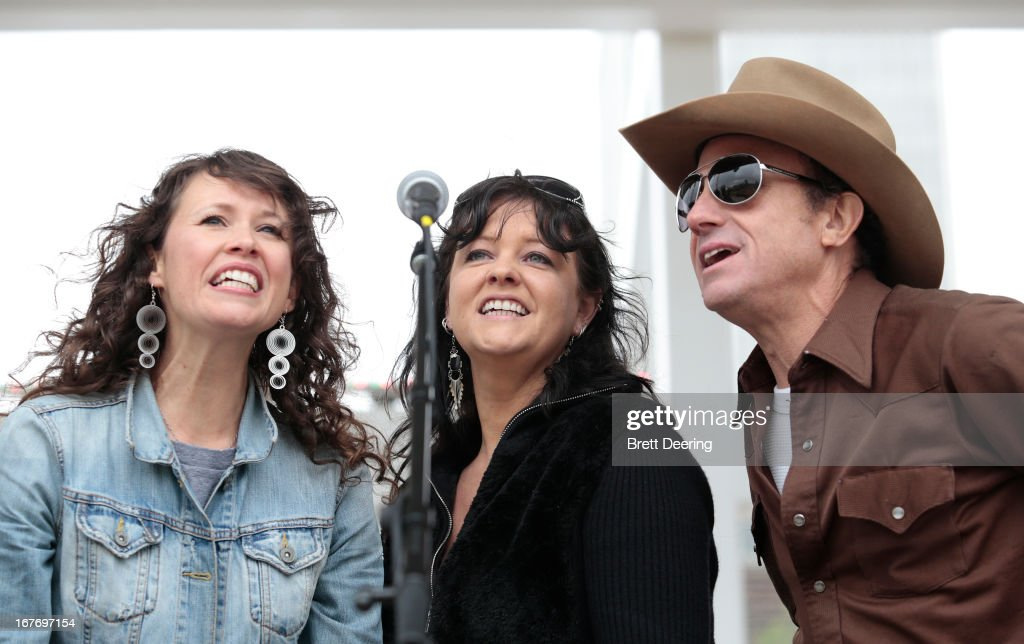 Sarah Lee Guthrie and Annie Guthrie and Brad Piccolo perform during the opening ceremony of the Woody Guthrie Center on April 27, 2013 in Tulsa, Oklahoma.