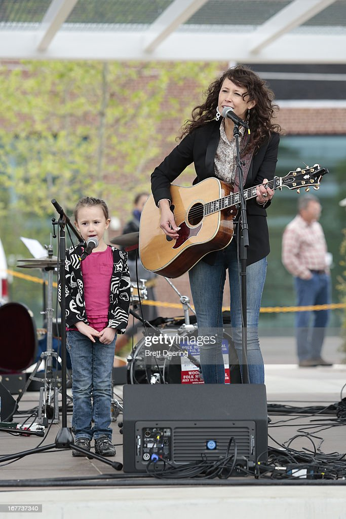 Sarah Lee Guthrie and daughter Sophia sing during opening ceremonies for the Woody Guthrie Center on April 27, 2013 in Tulsa, Oklahoma.