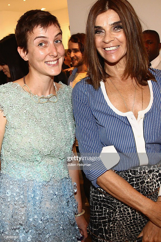 Sarah Lerfel (L) and <a gi-track='captionPersonalityLinkClicked' href=/galleries/search?phrase=Carine+Roitfeld&family=editorial&specificpeople=240177 ng-click='$event.stopPropagation()'>Carine Roitfeld</a> attend the cocktail for the launch of Claudia Schiffer cashmere collection at Colette on July 5, 2011 in Paris, France.