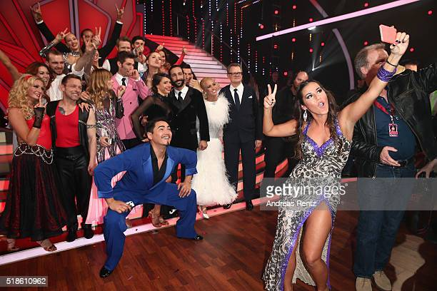 Sarah Lombardi takes a selfie with her team mates during the 3rd show of the television competition 'Let's Dance' on April 1 2016 in Cologne Germany