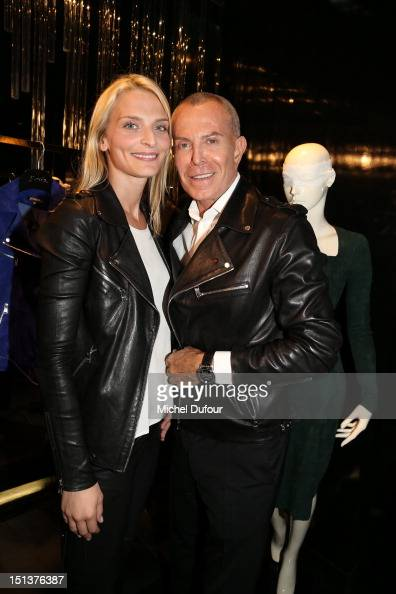 Sarah Marshall and Jean Claude Jitrois attend the Vogue Fashion Night at Shop Jitrois Out 2012 Fashion Night Out on September 6 2012 in Paris France