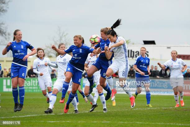 Sarah Mayling and Ellen White of Birmingham City Ladies jump for a header with Karen Carney of Chelsea Ladies during the SSE Women's FA Cup SemiFinal...