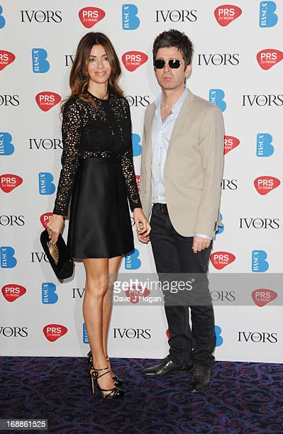 Sarah McDonald and Noel Gallagher attend the Ivor Novello Awards 2013 at The Grosvenor House Hotel on May 16 2013 in London England