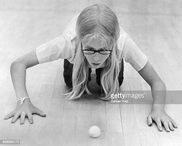 Sarah McGee of Troop 667 keeps Ping Pong ball rolling across floor with puffs of wind The Girl Scouts competed two at a time Sarah was the winner in...