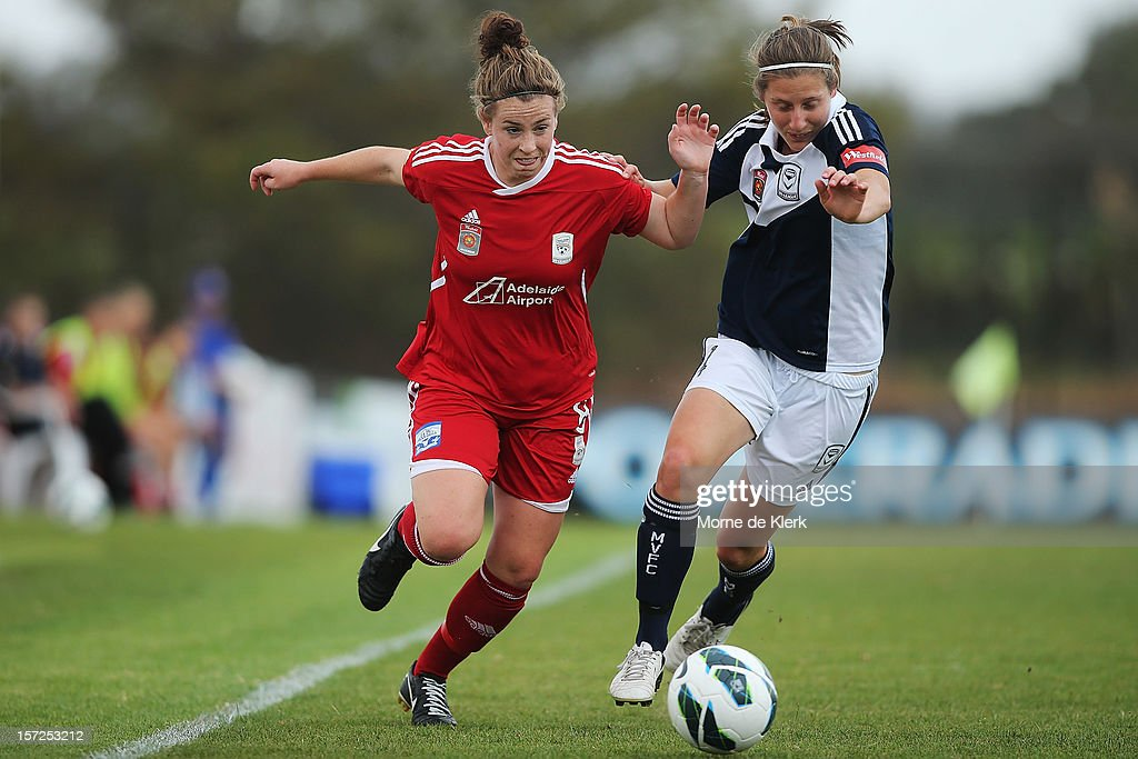 Sarah McLaughlin of Adelaide competes with Rebekah Stott of Melbourne during the round seven W-League match between Adelaide United and the Melbourne Victory at Burton Park on December 1, 2012 in Adelaide, Australia.