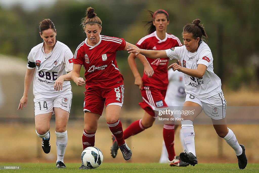 Sarah McLaughlin of Adelaide is put under pressure by Ella Mastantonio of Perth during the round 12 W-League match between Adelaide United and the Perth Glory at Burton Park on January 12, 2013 in Adelaide, Australia.
