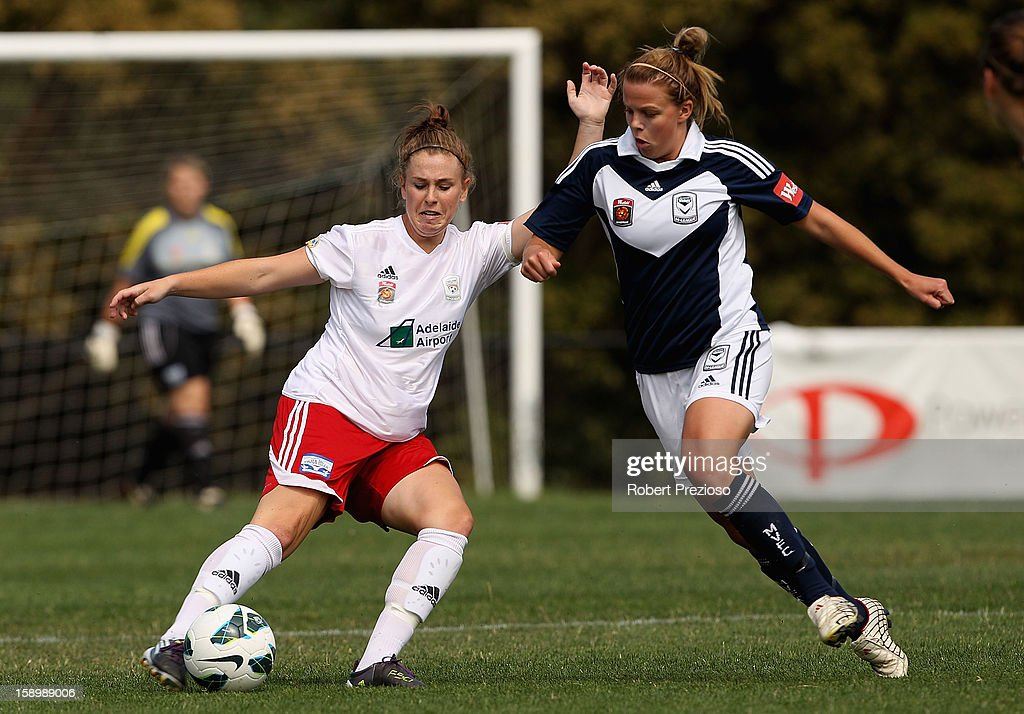 Sarah McLaughlin of Adelaide kicks the ball during the round 11 W-League match between the Melbourne Victory and Adelaide United at Wembley Park on January 5, 2013 in Melbourne, Australia.