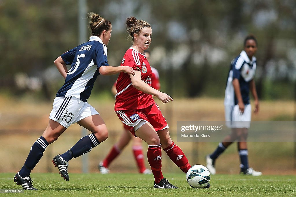 Sarah McLaughlin of Adelaide passes the ball forward during the round seven W-League match between Adelaide United and the Melbourne Victory at Burton Park on December 1, 2012 in Adelaide, Australia.