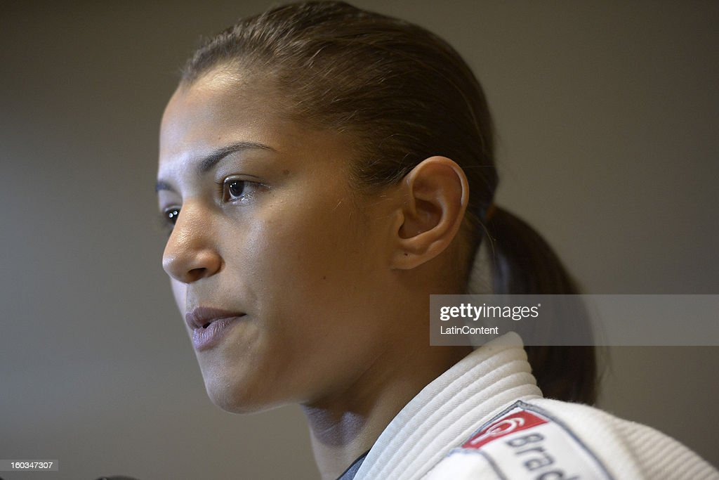 <a gi-track='captionPersonalityLinkClicked' href=/galleries/search?phrase=Sarah+Menezes&family=editorial&specificpeople=6652788 ng-click='$event.stopPropagation()'>Sarah Menezes</a> looks on during the first official training season of the team, who will represent Brazil in the Olympic Games Rio 2016, at Maria Lenk Aquatic Center on January 29, 2013 in Rio de Janeiro, Brazil.