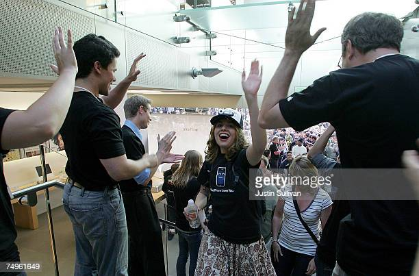 Sarah Meyers high fives Apple employees as she enters the Apple store to purchase the new iPhone June 29 2007 in San Francisco California Hype for...