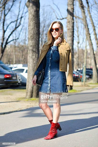 Sarah Mikaela poses wearing a Levi's jacket Alexa Chung X AG Jeans dress and vintage shoes and bag on Day 6 of Paris Fashion Week Womenswear FW15 on...