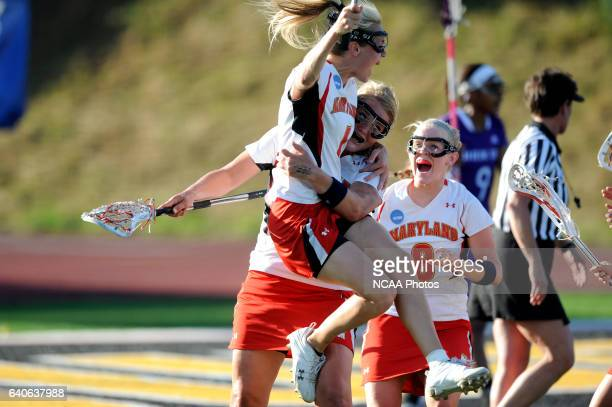 Sarah Mollison of Maryland celebrates with teammates Kristy Black and Karri Ellen Johnson of the University of Maryland during the Division I Women's...
