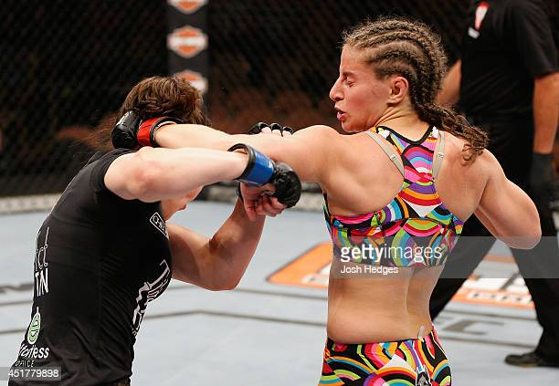 Sarah Moras punches Alexis Dufresne in their women's bantamweight fight during the Ultimate Fighter Finale inside the Mandalay Bay Events Center on...