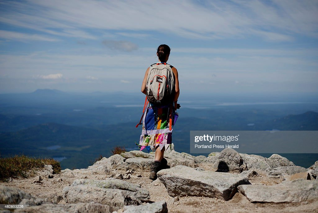 Sarah Morse of North Berwick, who goes by the trail name 'Leap Frog', takes in the view near the summit of Mount Katahdin after completing a hike of the Appalachian Trail.