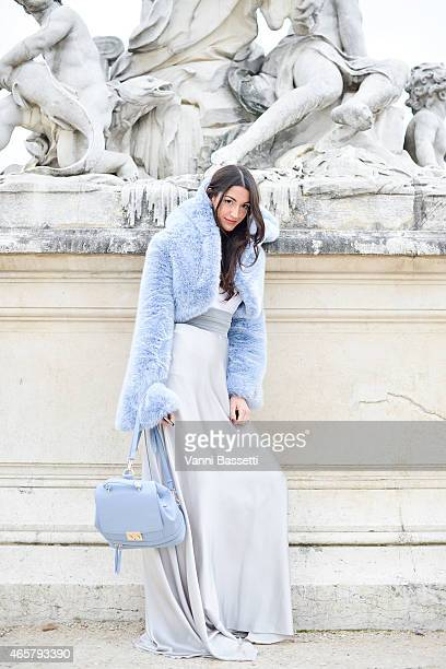 Sarah Nicole Rossetto poses wearing a The Lipstick Sisters fur and dress and Zara backpack on Day 8 of Paris Fashion Week Womenswear FW15 on March 10...