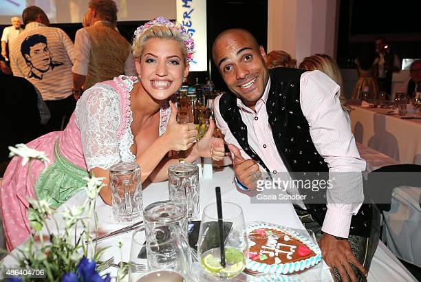 Sarah Nowak playmate of the year 2015 and David Odonkor during the Angermaier TrachtenNacht 2015 at Postpalast in Munich on September 3 2015 in...