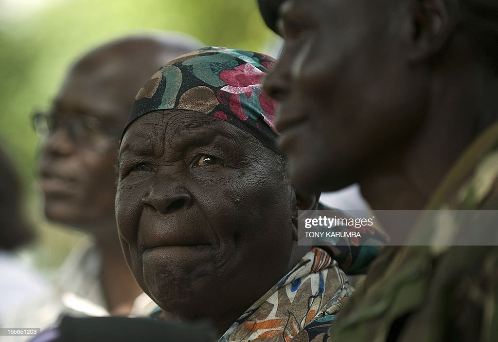 Sarah Obama, (C), step-grandmother to America's incumbent President Barack Obama sits among family members and local leaders during a press conference held at her homestead, on November 6, 2012 in the village of Kogelo in western Kenya,where Obama's father was born. 'I pray for him, for God to help him. It is a tough race so i have prayed for him. If this is his turn, God will let him triumph', she said in her local 'Luo' tongue. Americans headed to the polls on November 6, 2012 after a burst of last-minute campaigning by President Barack Obama and Mitt Romney in a nail-biting contest unlikely to heal a deeply polarized nation. AFP PHOTO/Tony KARUMBA