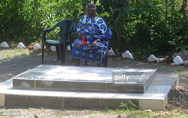 Sarah Onyango Obama US President Barack Obama step grandmother sits in the garden close to a grave of her son on July 14 2015 at her home in Kogelo...