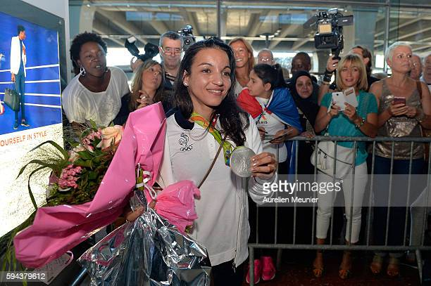 Sarah Ourahmoune boxing Silver medalist arrives at Roissy Charles de Gaulle airport after the Olympic Games in Rio on August 23 2016 in Paris France...
