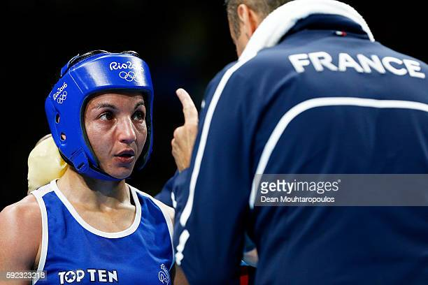 Sarah Ourahmoune of France receives instructions from her corner during the Women's Fly Final Bout against Nicola Adams of Great Britain on Day 15 of...