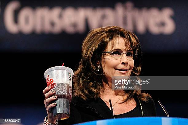 Sarah Palin former Governor of Alaska holds up a large soda as she speaks about New York City Mayor Michael Bloomberg's proposed large soda ban at...