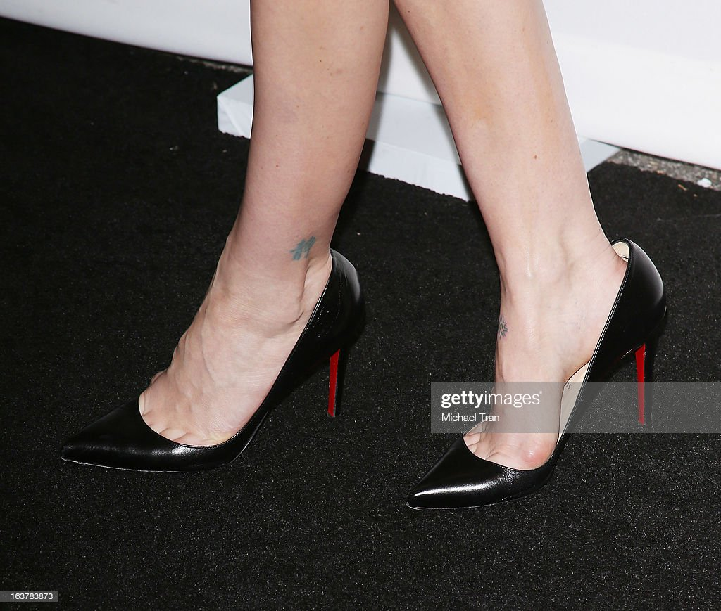 <a gi-track='captionPersonalityLinkClicked' href=/galleries/search?phrase=Sarah+Paulson&family=editorial&specificpeople=220657 ng-click='$event.stopPropagation()'>Sarah Paulson</a> (shoe and tattoo detail) arrives at the 30th Annual PaleyFest: The William S. Paley Television Festival - 'American Horror Story: Asylum' - closing night presentation held at Saban Theatre on March 15, 2013 in Beverly Hills, California.