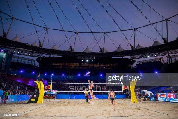 Sarah Pavan of Canada spikes the ball during the match against Laura Ludwig and Kira Walkenhorst of Germany during Day 3 of the Swatch Beach...
